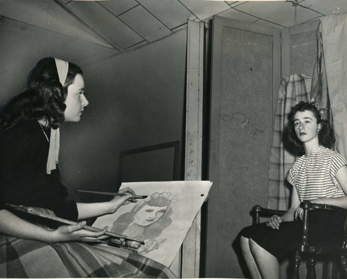 Two young women in a portrait drawing class at the St. Paul School of Art