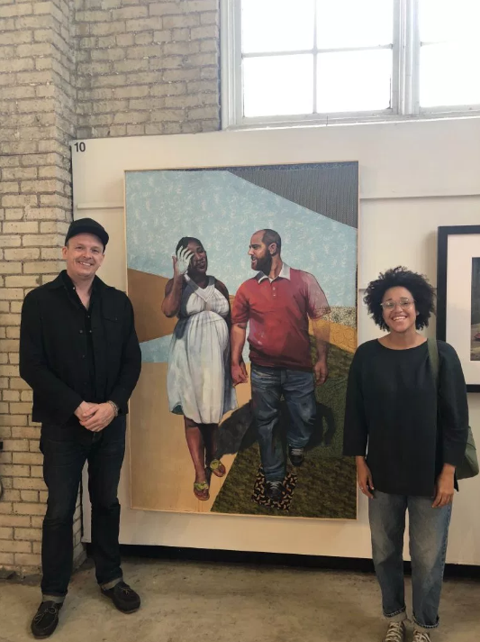 M Curator of Exhibitions Christopher Atkins and Curatorial Fellow Johnnay Leenay at this year's Minnesota State Fair Fine Arts Exhibition
