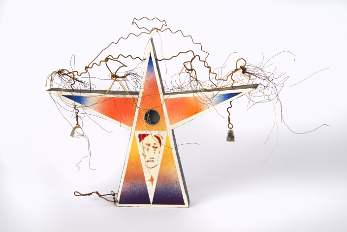 """Brad Kahlhamer, """"Next Level Figure 20,"""" 2014. Wood, wire, rope, bells, acrylic and spray paint. Sculpture: 12 x 16 x 2 1/2 inches. Courtesy of the artist and Jack Shainman Gallery."""